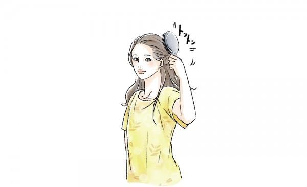 ブラシで頭皮マッサージをする女性のイラスト